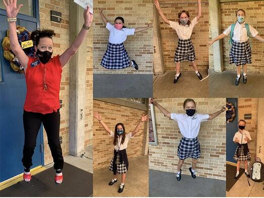Students jump for joy at winning a temperature kiosk